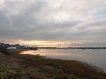 Sunset over coast ocean bay water sky sea boats. Essex; england; uk Stock Image