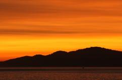 Sunset over coastal mountains Royalty Free Stock Photography