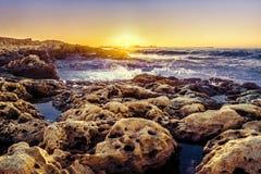 Sunset over Coastline Stock Photo