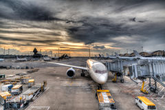 Sunset Over Commercial Aircrafts on Airport Tarmac Stock Images