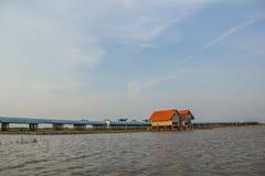 Sunset over concrete bridge on lake, Thale Noi, Phatthalung Royalty Free Stock Images