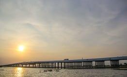 Sunset over concrete bridge on lake, Thale Noi, Phatthalung Royalty Free Stock Photography