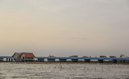 Sunset over concrete bridge on lake, Thale Noi, Phatthalung Stock Photo