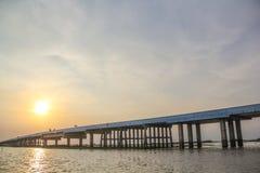 Sunset over concrete bridge on lake, Thale Noi, Phatthalung Royalty Free Stock Photos