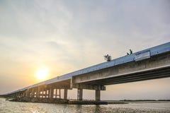 Sunset over concrete bridge on lake, Thale Noi, Phatthalung Stock Photos