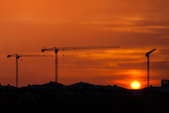 Sunset over the construction crane Stock Photos
