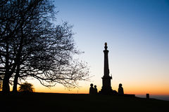 Sunset over the Coombe Hill Memorial in the Chiltern Hills. Golden sunset over the Coombe Hill Memorial Chiltern Hills, Buckinghamshire, United Kingdom Stock Image