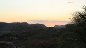 Sunset over the Costa Rica trees 4K. A Sunset over the Costa Rica trees 4K stock video footage