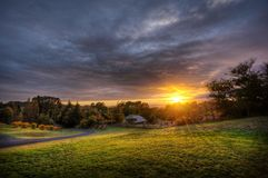 Sunset over country field Royalty Free Stock Images