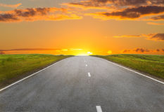 Sunset over the country highway Royalty Free Stock Photo