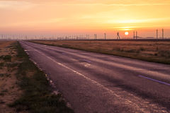 Sunset over the country highway Royalty Free Stock Photography