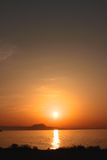 Sunset over the Cretan coast, portrait view. Stock Photo