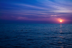 Sunset over crystal blue ocean Royalty Free Stock Images
