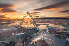 Sunset over the crystal ice of Baikal lake Royalty Free Stock Photography
