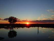 Sunset over a Dam, Longreach, Queensland Royalty Free Stock Photos