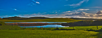Sunset over a dam. Panorama of a sunset over a coastal rural property with a water feature Royalty Free Stock Photography