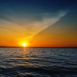 Sunset over dark water Stock Image