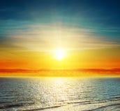 Sunset over darken sea Royalty Free Stock Photography