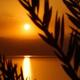 Sunset over the Dead Sea, view from the Jordanian shore to the Israeli mountains. Middle east Stock Images
