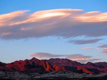 Sunset over Death Valley Mountainscape. Pastel sunset over red desert mountains, Death Valley National Park, California, United States of America Stock Photos