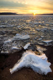 Sunset over Deer Lake Icy shore royalty free stock images