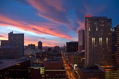 Sunset over Denver. A view of a beautiful sunset over the city of Denver, Colorado, while looking along the popular 16th Street Pedestrian Mall on a late fall Stock Images