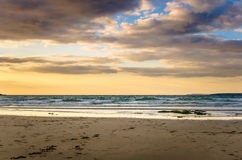Sunset over a Deserted Sandy Beach Stock Photography