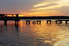 Sunset over destroyed jetty, Masuria, Poland. View on lake and very colorfull sunset , podlasie, Poland Stock Image