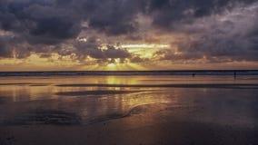 Sunset over Devon Beach. Dog walker at Sunset over Devon Beach England royalty free stock images