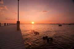 Sunset over dock Stock Photo