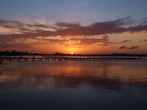 Sunset over dock on Cancun Bay. Rare shot over the bay in Cancun Stock Photography