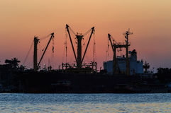 Sunset over dock ship or harbor near river Royalty Free Stock Photo