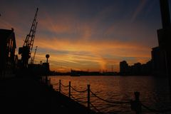 Sunset over the docks Stock Photos