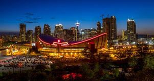 Sunset Over Downtown Calgary and Saddledome Royalty Free Stock Photo