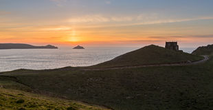 Sunset over Doyden Castle on coastline at Port Quin Royalty Free Stock Photo