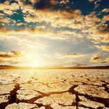 Sunset over drought earth Stock Photos