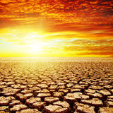 Sunset over drought earth Stock Images