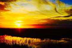 Sunset over Drummond. A beautiful sunset over the coastal marshland of Drummond  Point Park Amelia Island Florida Stock Images