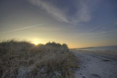 Sunset over the dunes of the Baltic Sea stock images