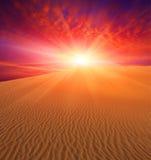 Sunset over dunes Stock Image