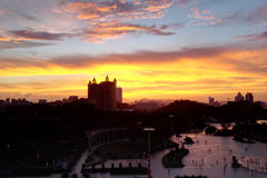 The Sunset Over East Lake. The beautiful sunset over the east lake of Jiangmen,China。People came to the park to enjoy the time after work royalty free stock images