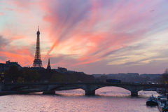 Sunset over Eiffel Tower and Seine river. Royalty Free Stock Image
