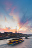 Sunset over Eiffel Tower and Seine river. Stock Image