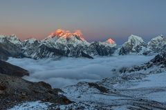 Sunset over Everest summit, view from Renjo La. Sunset over Everest summit, view from Renjo La pass. Breathtaking view of mountain valley covered with curly royalty free stock photography