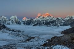 Sunset over Everest summit, view from Renjo La. Sunset over Everest summit, view from Renjo La pass. Fancy photo stock photography