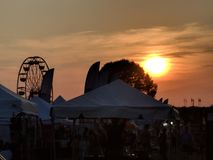 Sunset over the fair stock image