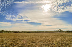 Sunset over farm field Royalty Free Stock Photography