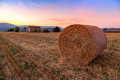 Sunset over farm field with hay bales near Sault Royalty Free Stock Images