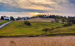 Sunset over farm fields and hills in Lancaster County, Pennsylva Stock Photo