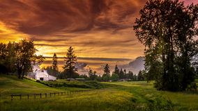 Sunset over a Farm and Meadow Stock Images